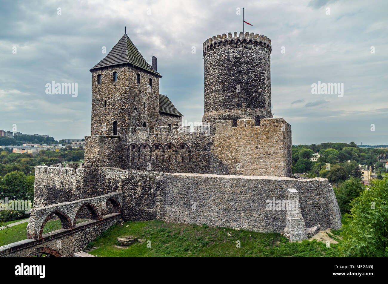 Medieval roman feudal castle fort on the hill beneath cloudy steel sky in Bedzin, Silesian Upland, Poland. - Stock Image