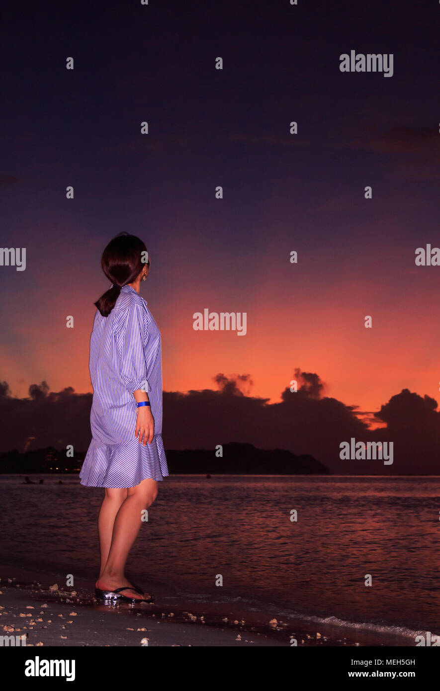 Girl Looking Up The Sky In Th Sunset At Tumon Beach Guam Stock Photo Alamy