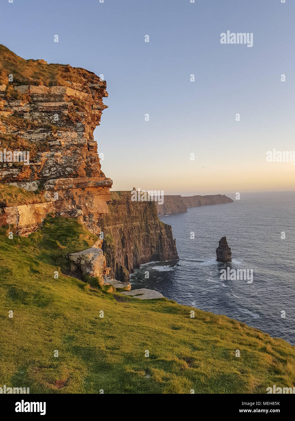 Beautiful Scenic Aerial drone view of Ireland Cliffs Of Moher in County Clare. Sunset over the Cliffs of Moher. Epic Irish rural countryside landscape - Stock Image
