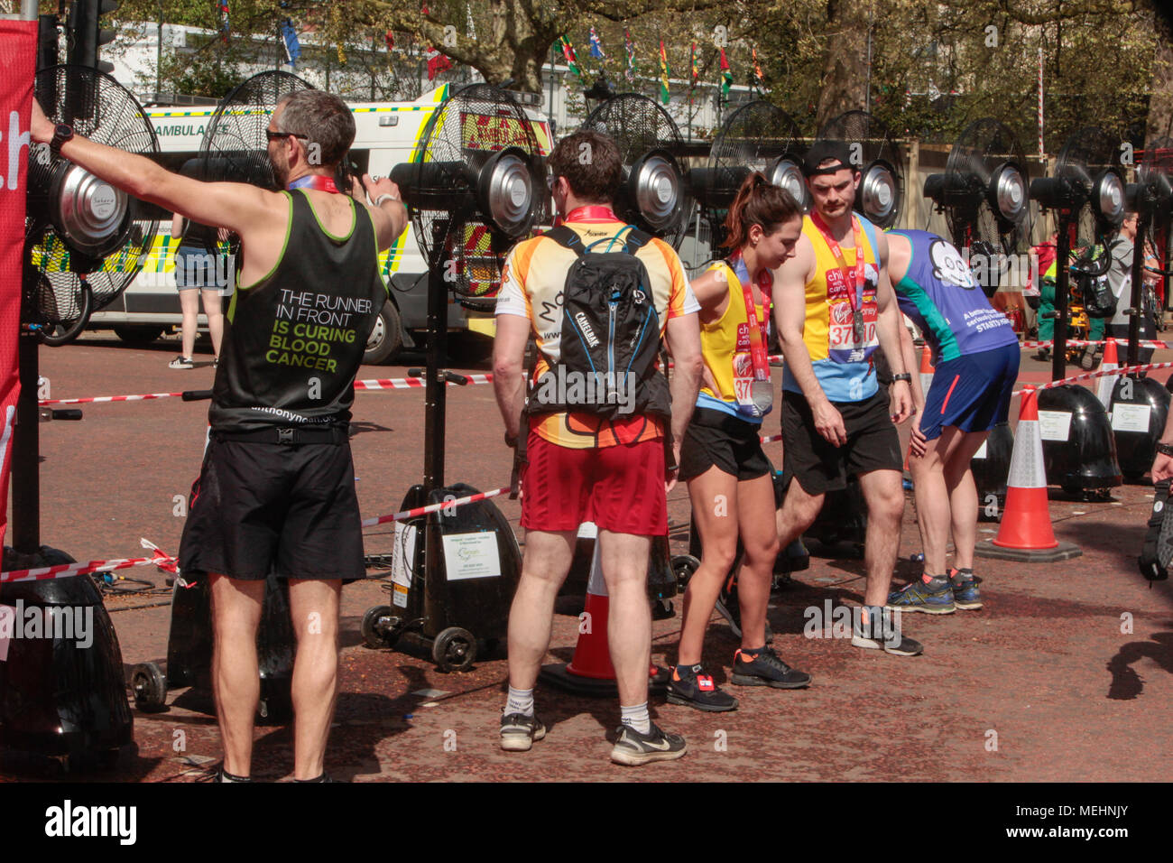 London UK 22 April 2018 The London Marathon was run in extreme heat and many people needed assistance at the finish ,while others cool down in big fans positioned along the mall @Paul Quezada-Neiman/Alamy Live News Stock Photo