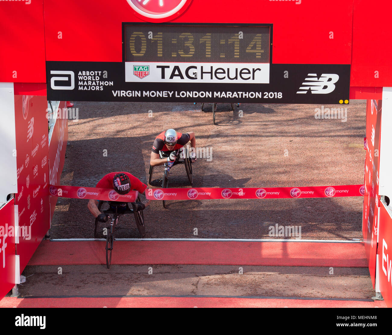 The Mall, London, UK. 22 April 2018. The Virgin Money London Marathon takes place in hot sun with athletes finishing on The Mall. David Weir (GBR) winning Elite Men's Wheelchair race. Credit: Malcolm Park/Alamy Live News. Stock Photo