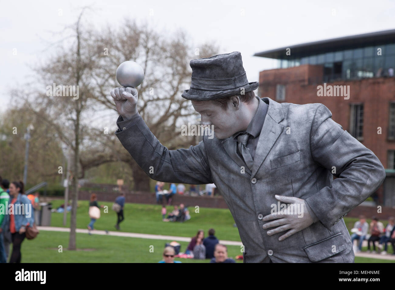 Stratford upon Avon, Warwickshire, 22nd April 2018. The Silver Hand, British artist no S04. The final day of the U.K's First Living Statue Competition in Bancroft gardens which has been held over 3 days, as part of Shakespeare 454th Birthday Celebrations a unique event showcasing some of the best artists from around the world, including World and National Champions. Credit: Keith J Smith./Alamy Live News - Stock Image