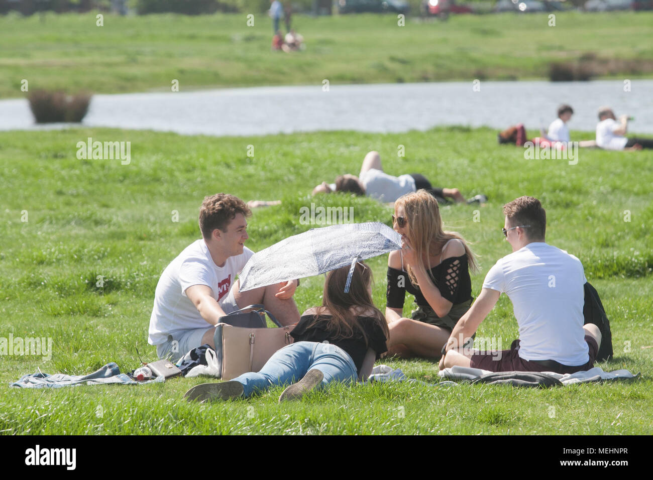 London UK. 22nd April 2018 People enjoying the afternoon  sunshine and warm spring  weather on Wimbledon Common on another glorious hot day in London as temperatures climb to the mid 20's celsius Credit: amer ghazzal/Alamy Live News Stock Photo