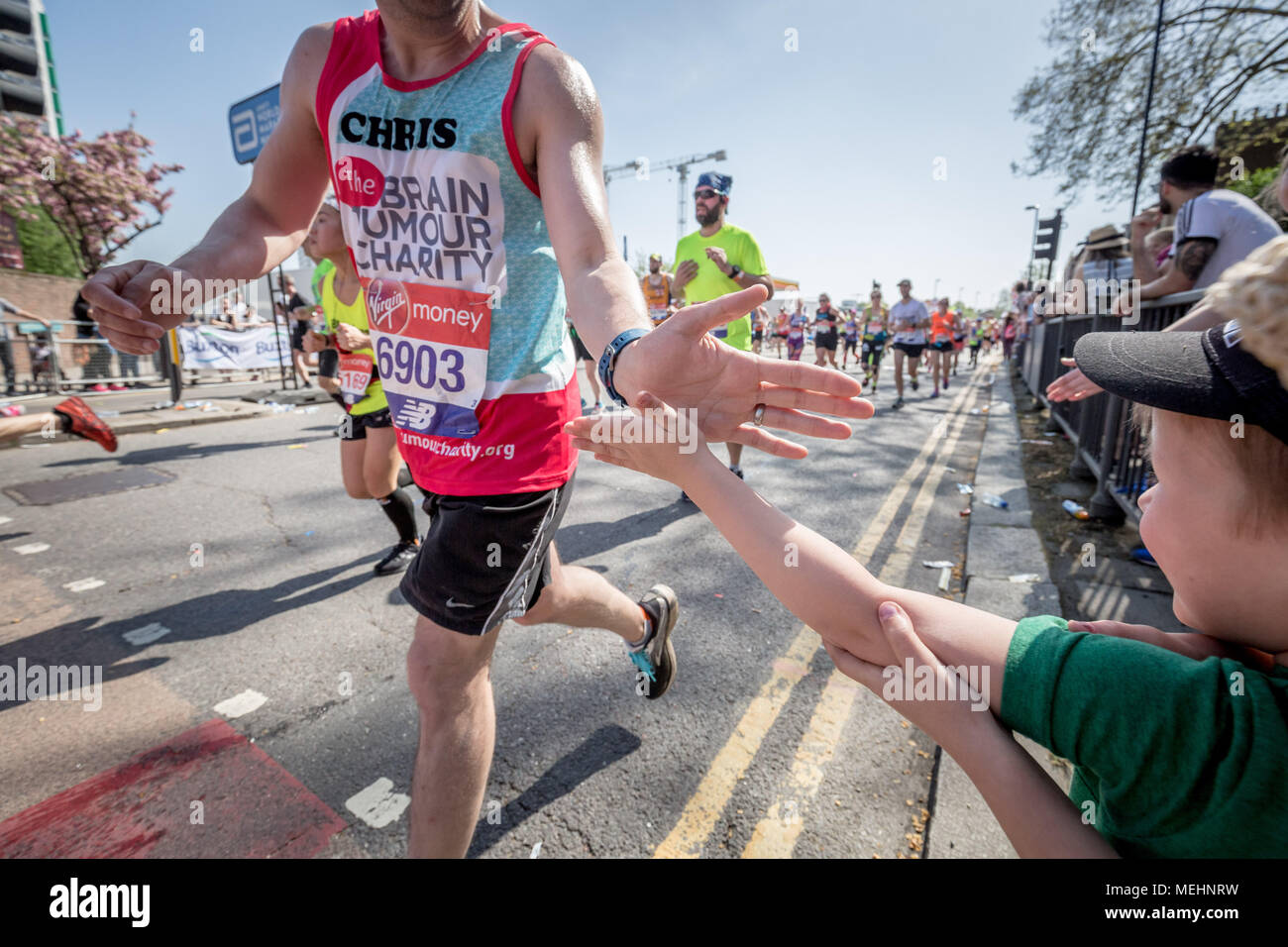 London, UK. 22nd April, 2018. 38th London Marathon passes through Deptford. Credit: Guy Corbishley/Alamy Live News Stock Photo