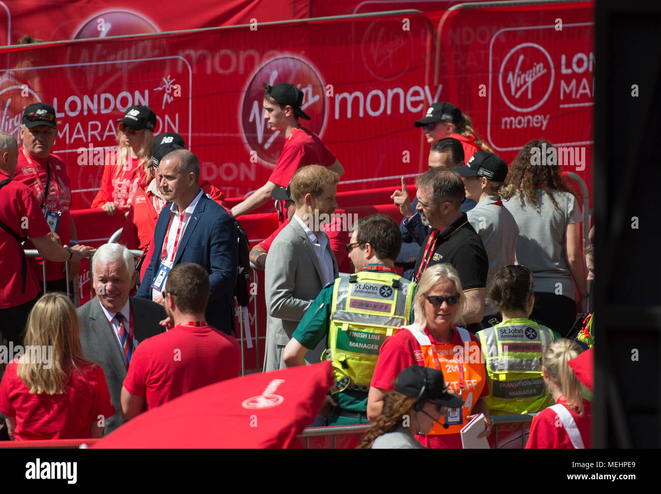 The Mall, London, UK. 22 April 2018. The Virgin Money London Marathon takes place in hot sun with athletes finishing on The Mall. Prince Harry arrives for the medal ceremony. Credit: Malcolm Park/Alamy Live News. Stock Photo