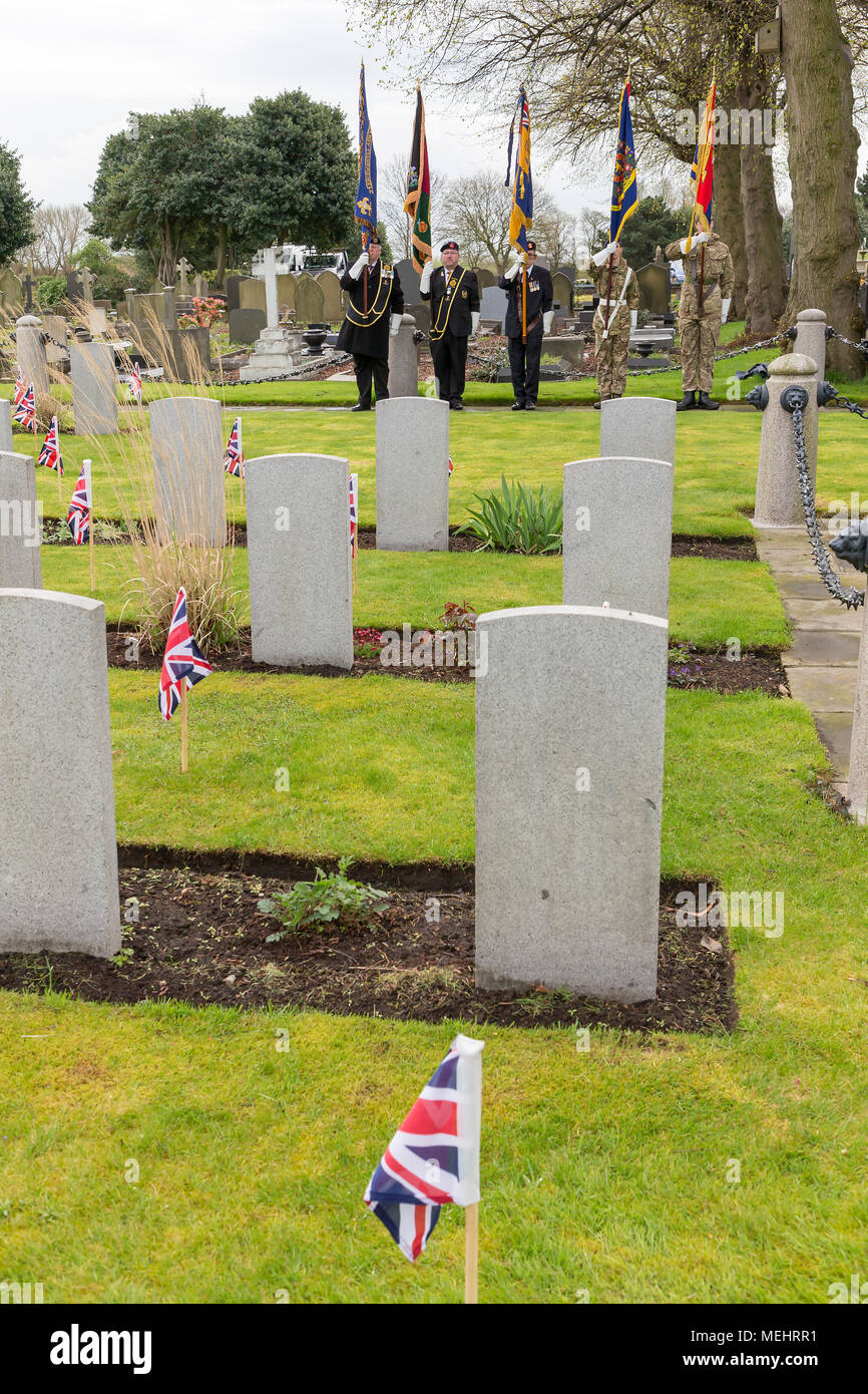 Standard Bearers proudly hold their colours near to the graves of ex-servicemen at Soldiers' Corner during the Service to commemorate the anniversary of ANZAC Day - Warrington, UK, 22 April 2018. The Anniversary of ANZAC Day has been commemorated on Sunday 22 April 2018 within Soldiers' Corner of Warrington Cemetery when the Deputy Mayor, Cllr Karen Mundry, Cadets from the Queen's Lancashire Regiment, Warrington Sea Cadets and many veterans were in attendance Credit: John Hopkins/Alamy Live News Stock Photo