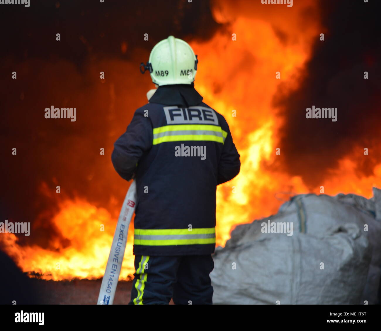 Kashar, Tirana-Albania, 22 April 2018. Huge fire burns completely a recycling company  in Kashar,  10 fire-units already on the scene struggling to extinguish the flames. NO injures or fatalities are reported Credit: Antonio Cakshiri/Alamy Live News Stock Photo