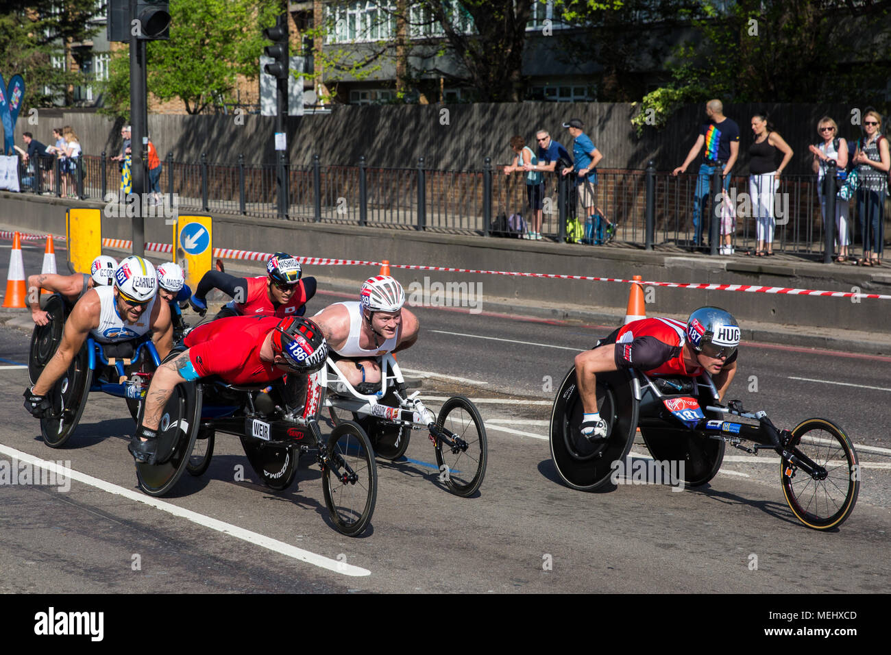 London, UK. 22nd April, 2018. David Weir (c) of Great Britain, eventual winner of the men's wheelchair (T53/T54) event, competes in the 2018 Virgin Money London Marathon. Marcel Hug (r) of Switzerland finished second. Credit: Mark Kerrison/Alamy Live News Stock Photo