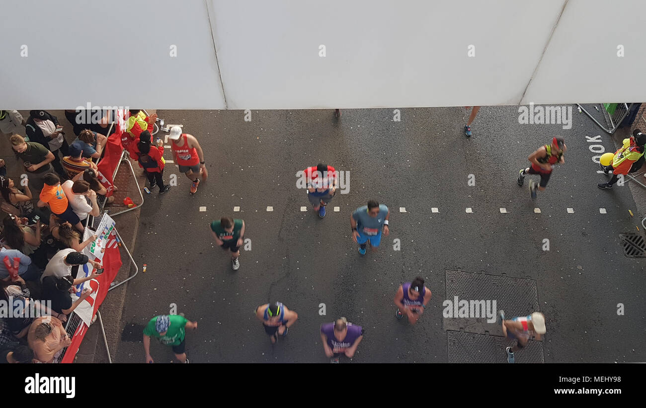 London, United Kingdom - April 22: Runners race towards the 20 mile mark at Canary Wharf during the Virgin Money London Marathon on April 22, 2018. Over 40,000 are expected to start the 26.2 miles run from Greenwich to Westminster.© David Mbiyu/Alamy Live News - Stock Image