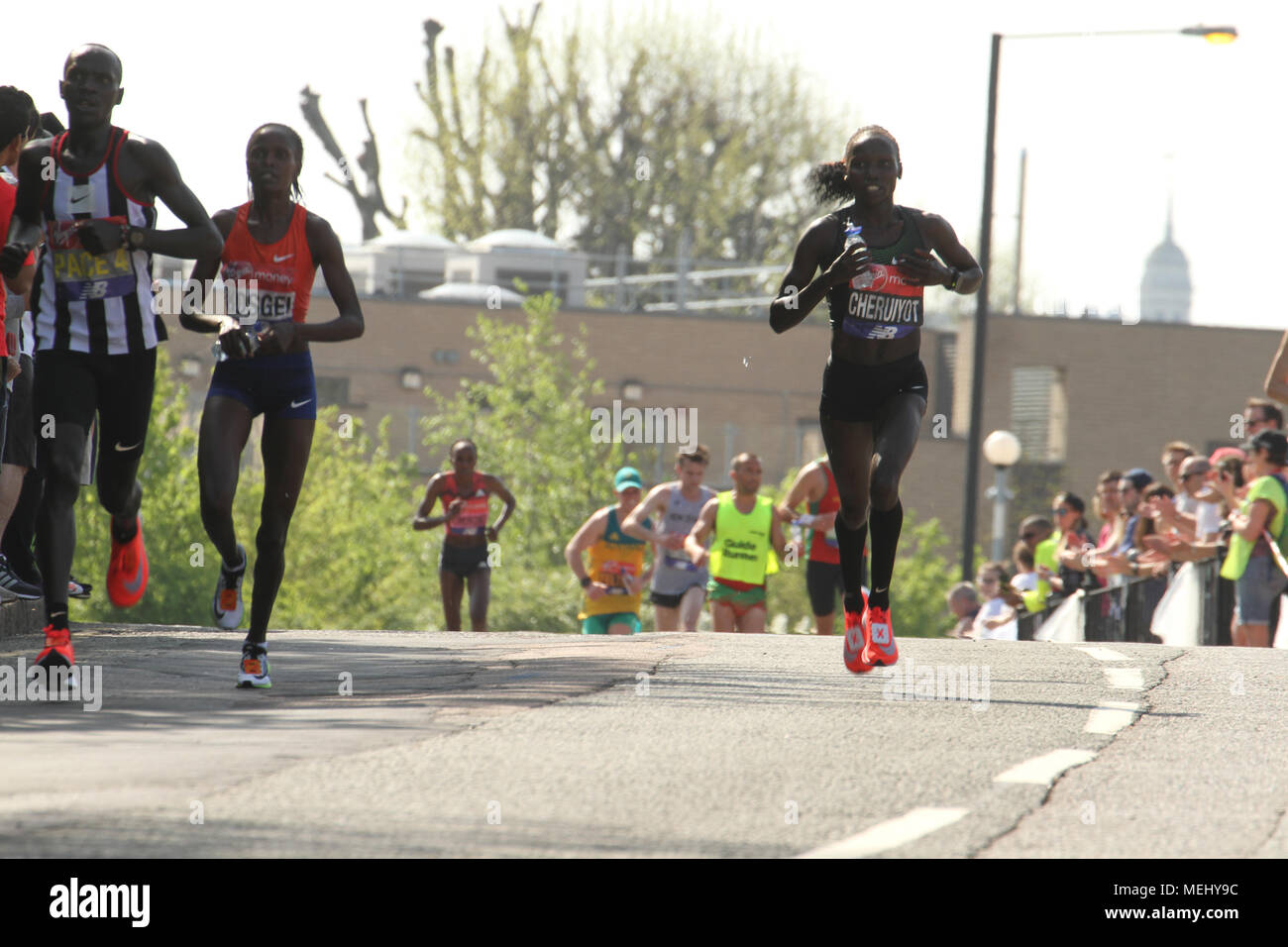 London, United Kingdom - April 22: Kenya runners Cheruiyot and Kosei race towards the 17 mile mark at Madchutte during the Virgin Money London Marathon on April 22, 2018. The two came in first and second respecively.  Over 40,000 are expected to start the 26.2 miles run from Greenwich to Westminster.© David Mbiyu/Alamy Live News - Stock Image