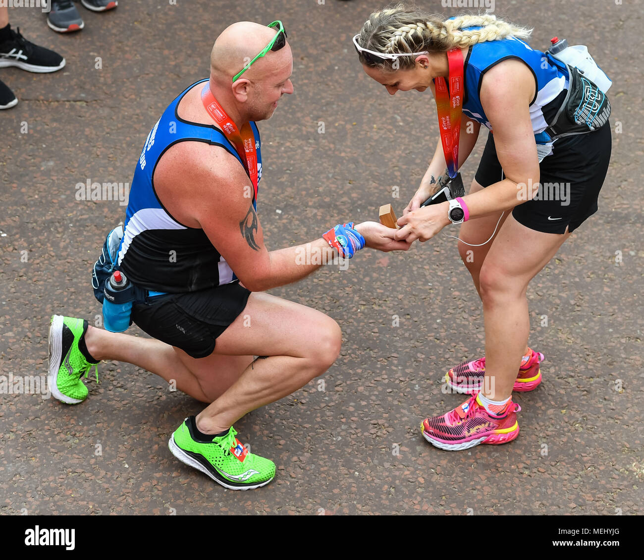 London, UK, 22 April 2018: Craig Dennen proposed to Lisa Lee at finish line during the 2018 Virgin Money London Marathon on Sunday, 22 April 2018. London, England. Credit: Taka G Wu Stock Photo