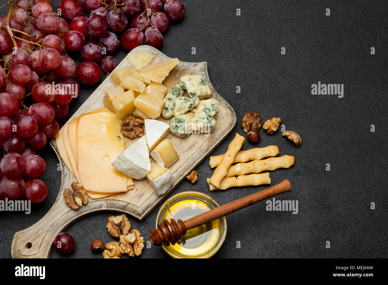 various types of cheese - brie, camembert, roquefort and cheddar - Stock Image
