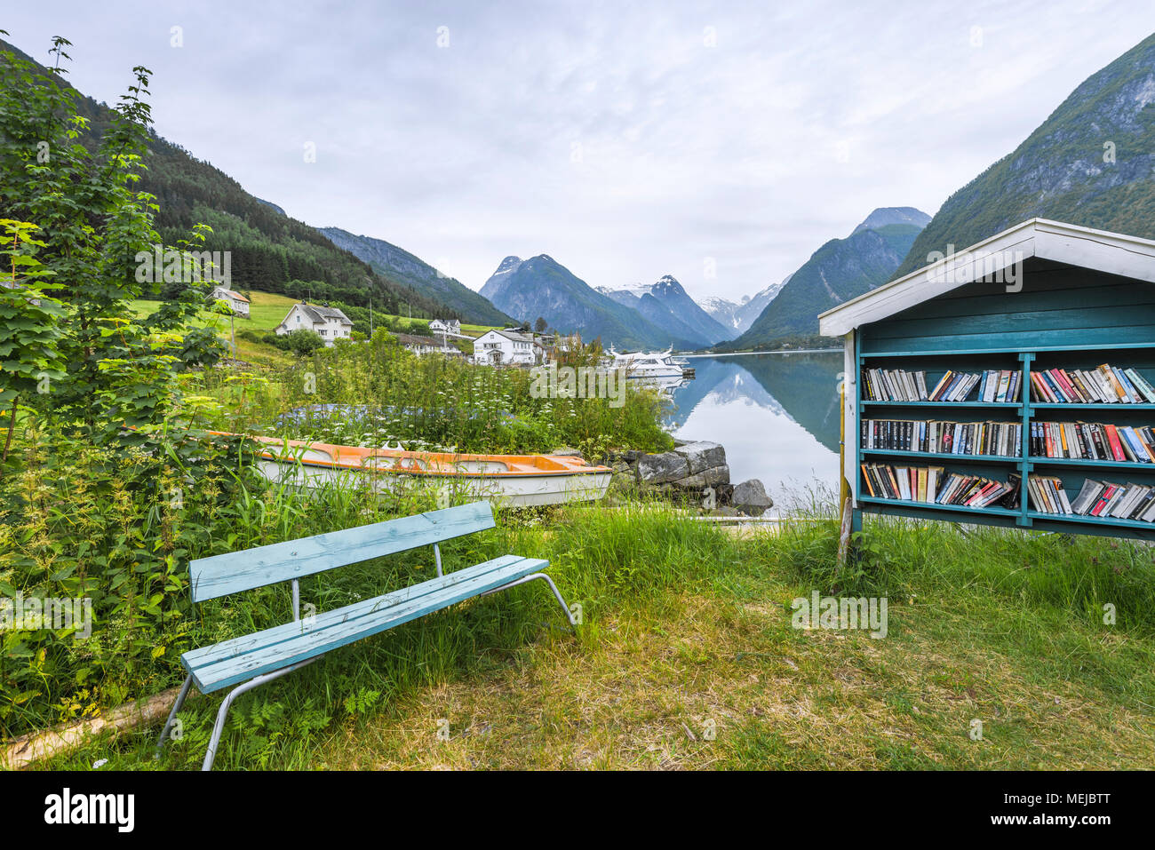 Outdoor Library And Bench At The Fjord Fjaerlandsfjorden Norway Public Bookshelf Boat Shore With Scenic Surroundings
