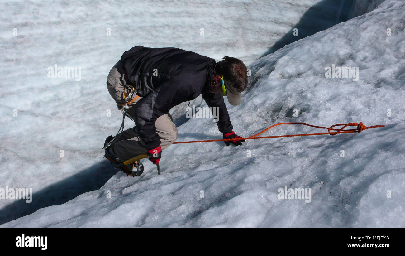 mountain guide candidate training ice axe and rope skills on a