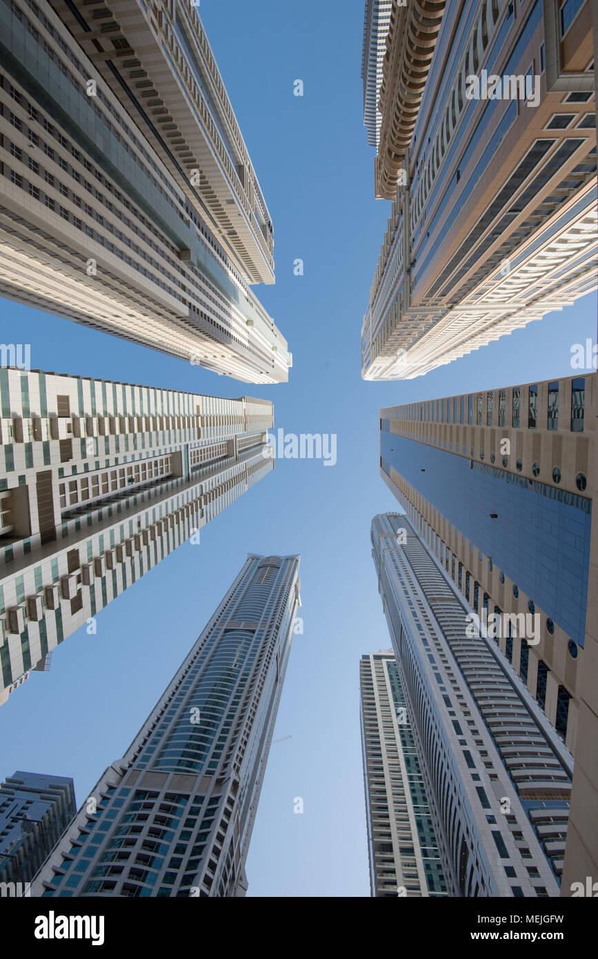 Skyscrapers in Dubai make pedestrians feel very small when viewed from below - Stock Image