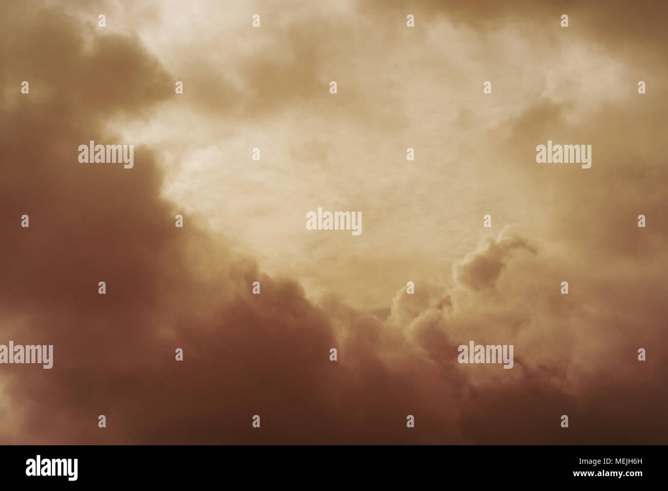 Sky covered with clouds in vintage style. Suitable for backgrounds. - Stock Image