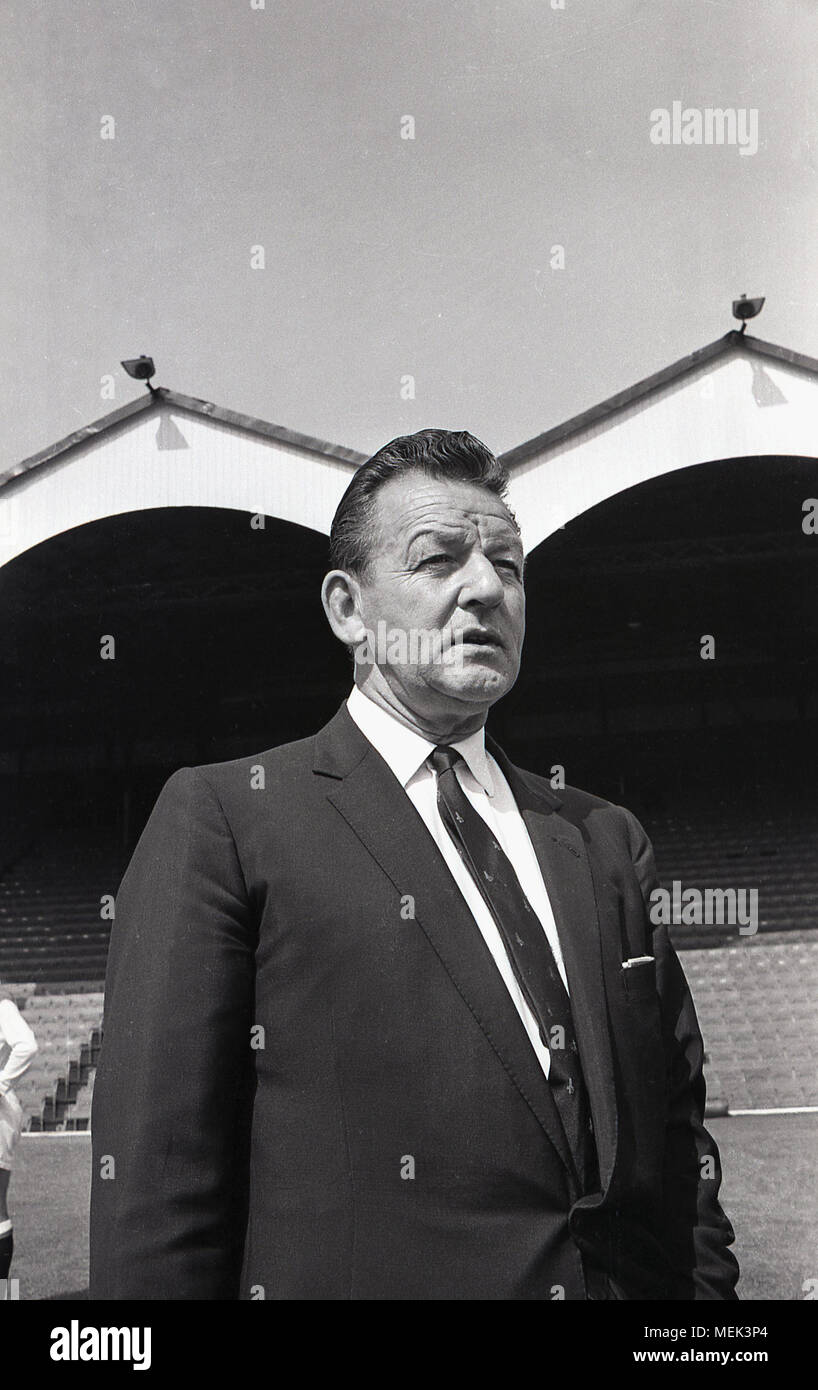 1964, historical picture of Frank Hill, the Scottish manager of Charlton Athletic FC, at their football ground, the Valley. He is wearing the new club tie. A former player for Arsenal in the Herbert Chapman era and nicknamed 'Tiger' Hill, he took Charlton to fourth in the1963–64 season, but was sacked in the summer of 1965. - Stock Image