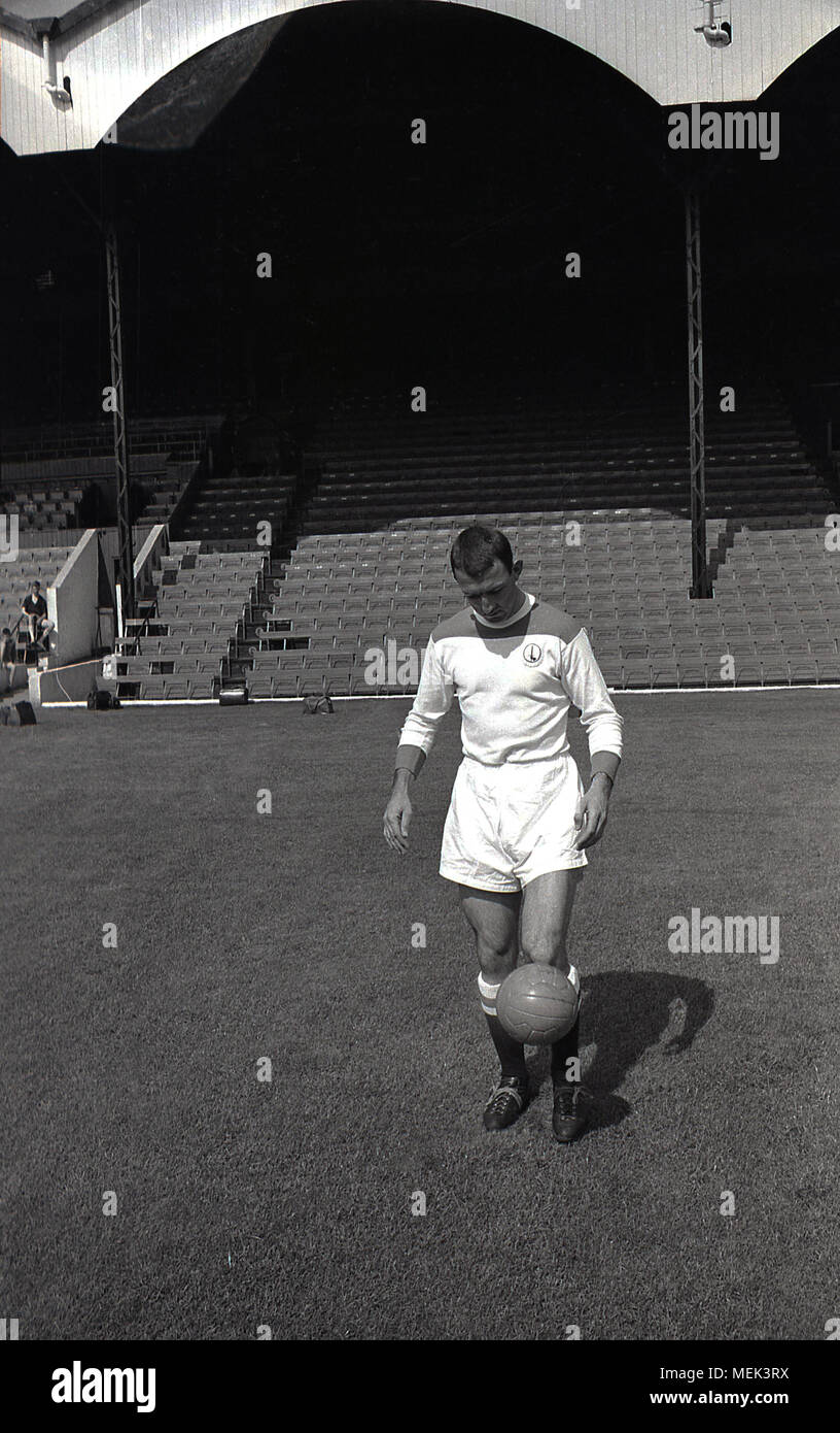 1964, Charlton Athletic FC, historical picture showing Charlton footballer Mike Bailey at the Valley do kick-up wearing their new football kit. Between 1964 and 1966 the Charlton players wore a new all white kit with red shoulders and the hand and sowrd badge first appeared on the shirt. - Stock Image