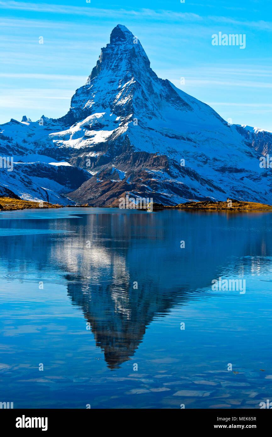 The Matterhorn, Mont Cervin, is reflected in lake Stellisee, Zermatt, Valais, Switzerland - Stock Image
