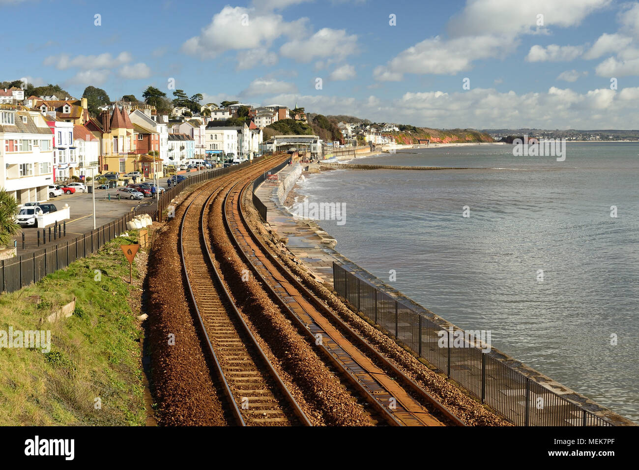 Missing fencing along the railway line at Dawlish following storm damage. - Stock Image