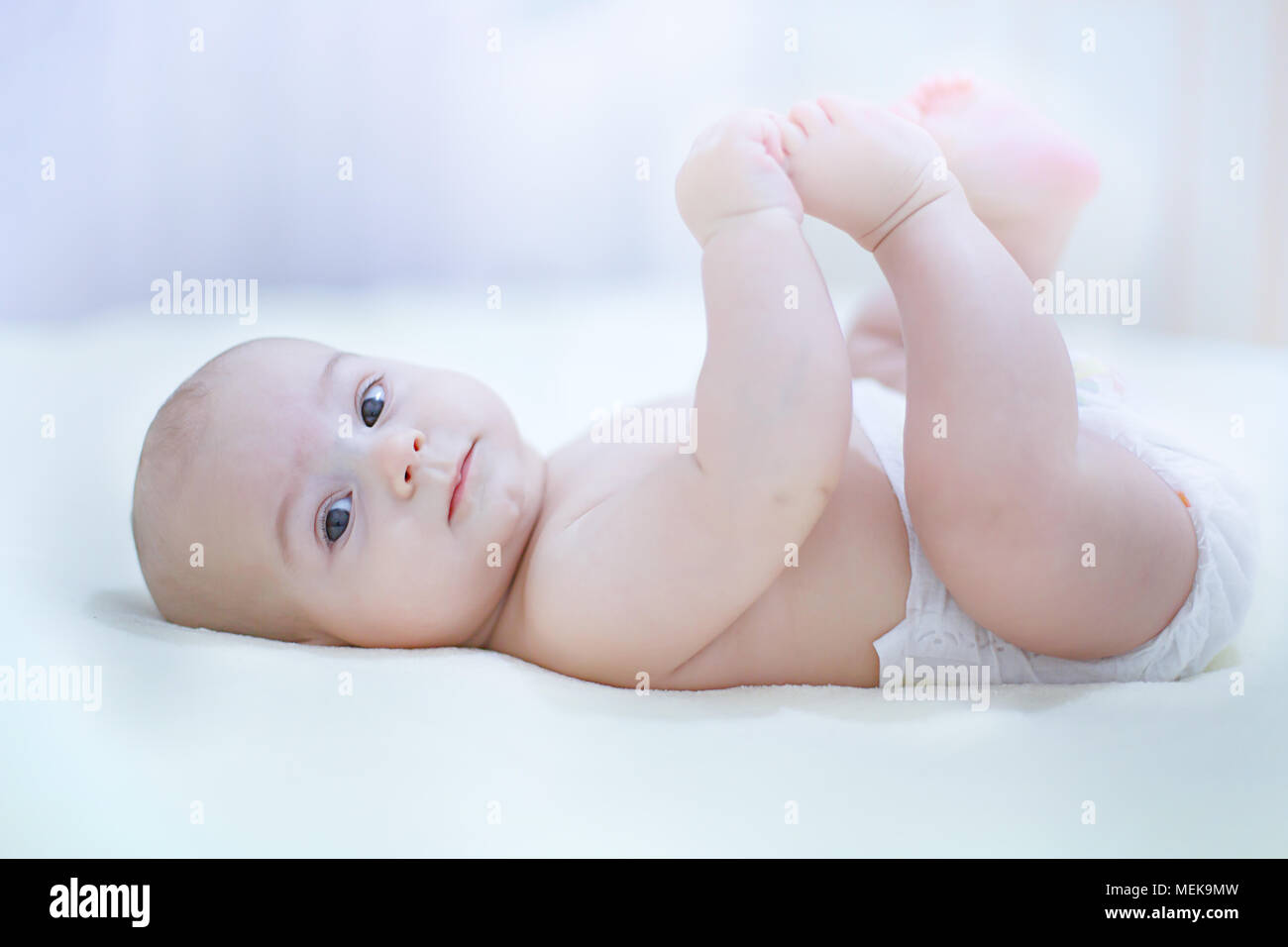 Cute baby infant boy wearing diaper playing