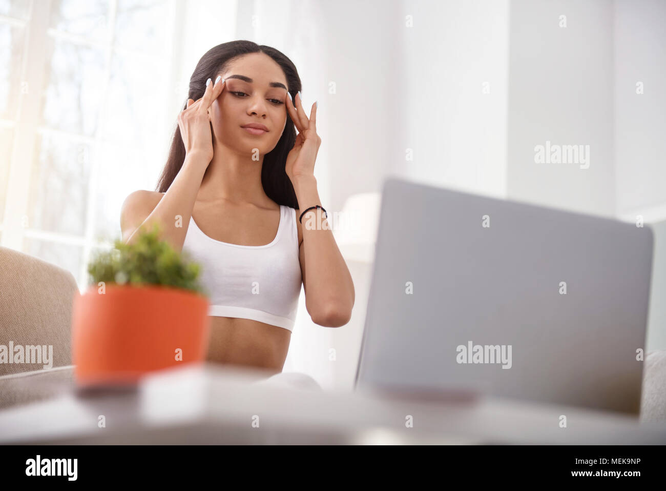 Pretty young woman learning anti-ageing massage - Stock Image