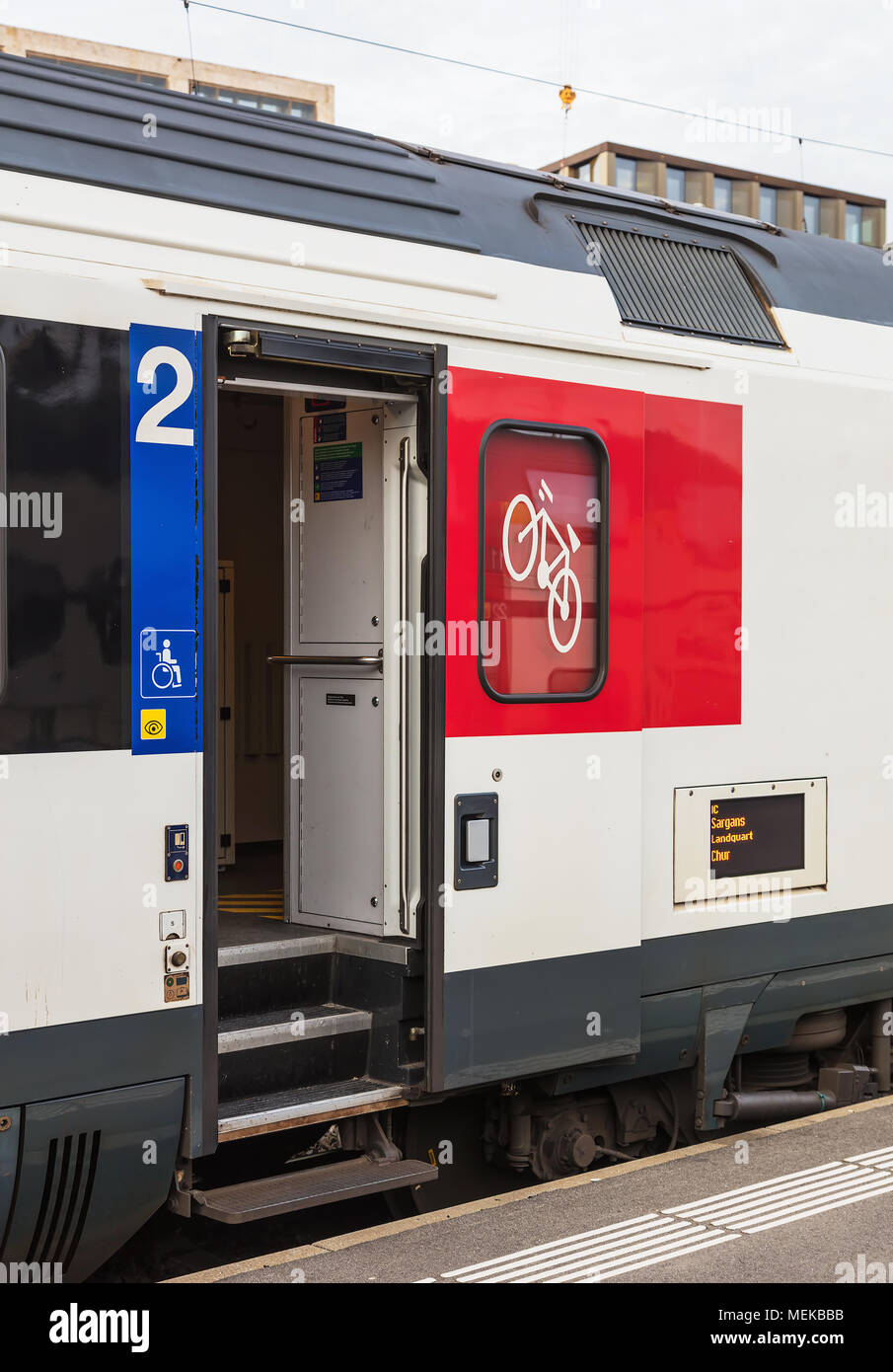 Zurich, Switzerland - 3 March, 2017: a door of a railroad car of a passenger train of the Swiss Federal Railways standing at a platform of the Zurich  - Stock Image