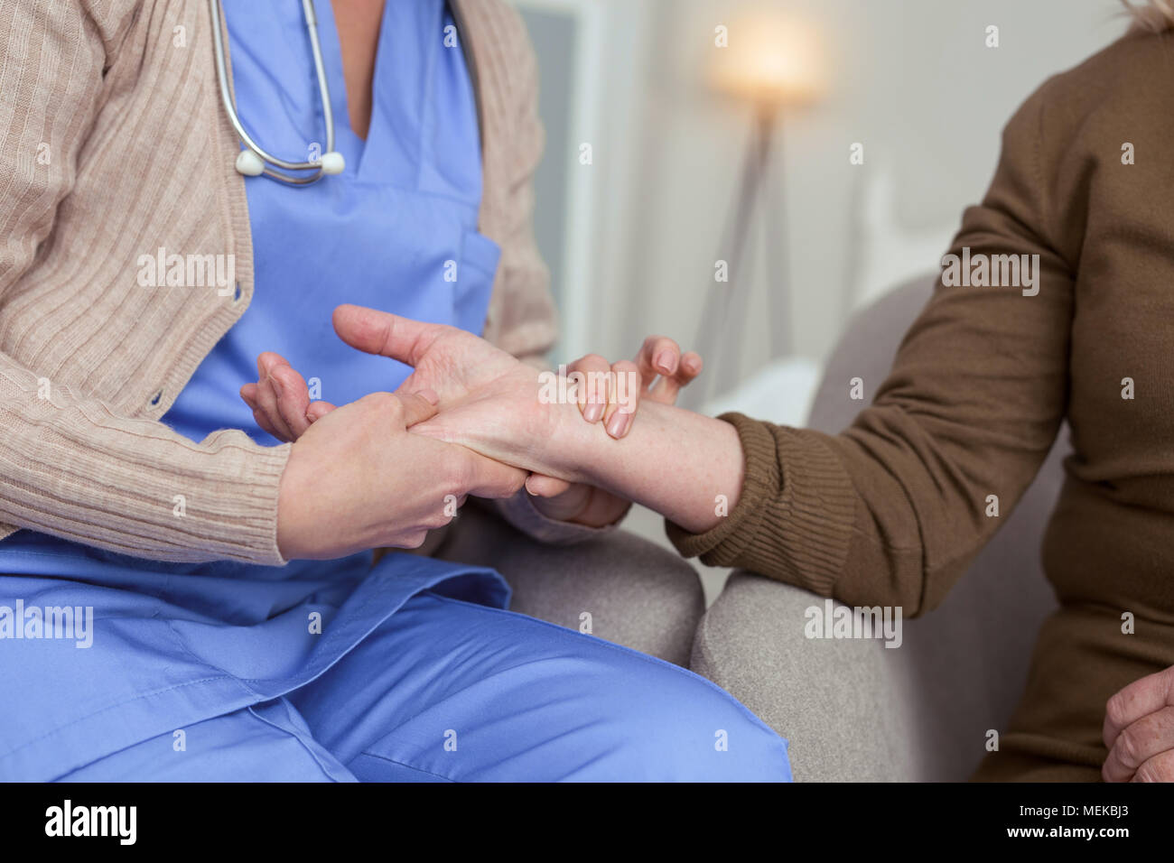 Young female hands noting pulse - Stock Image