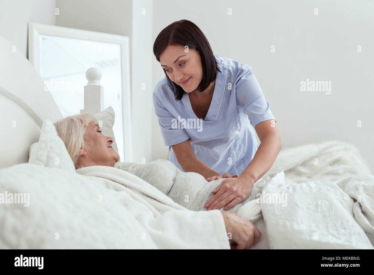 Appealing glad nurse setting pain area - Stock Image