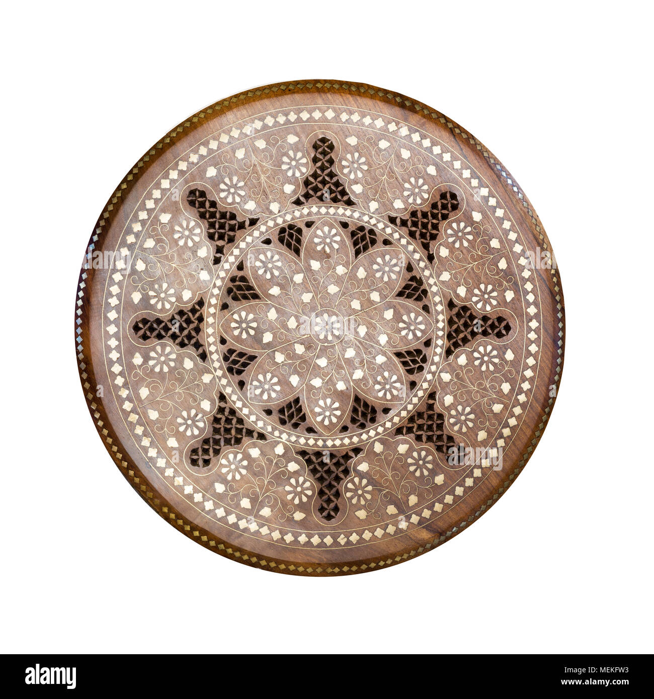 Handmade round wooden pattern. Ornamental circle floral decor panel with metal incrustation. Hadcraft vintage stool. Top view. Isolated on white. - Stock Image