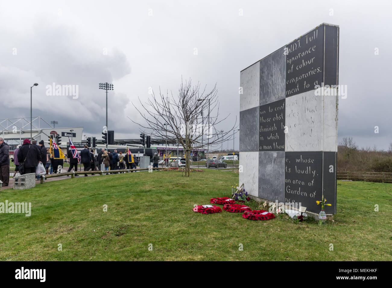 The memorial to Walter Tull, with flowers and wreaths, following a service in his honour; Sixfields, Northampton, UK - Stock Image