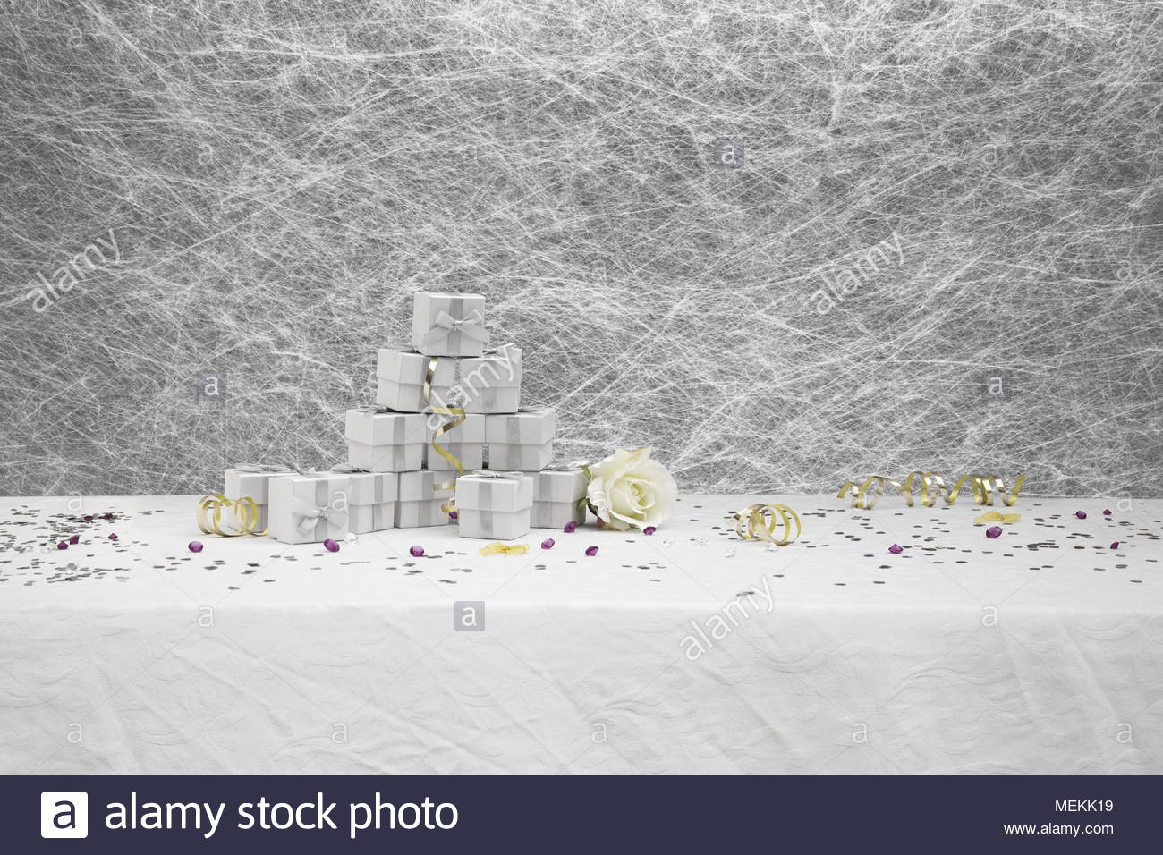 Wedding Favor boxes on a White tablecloth with gold ribbons,bows ...