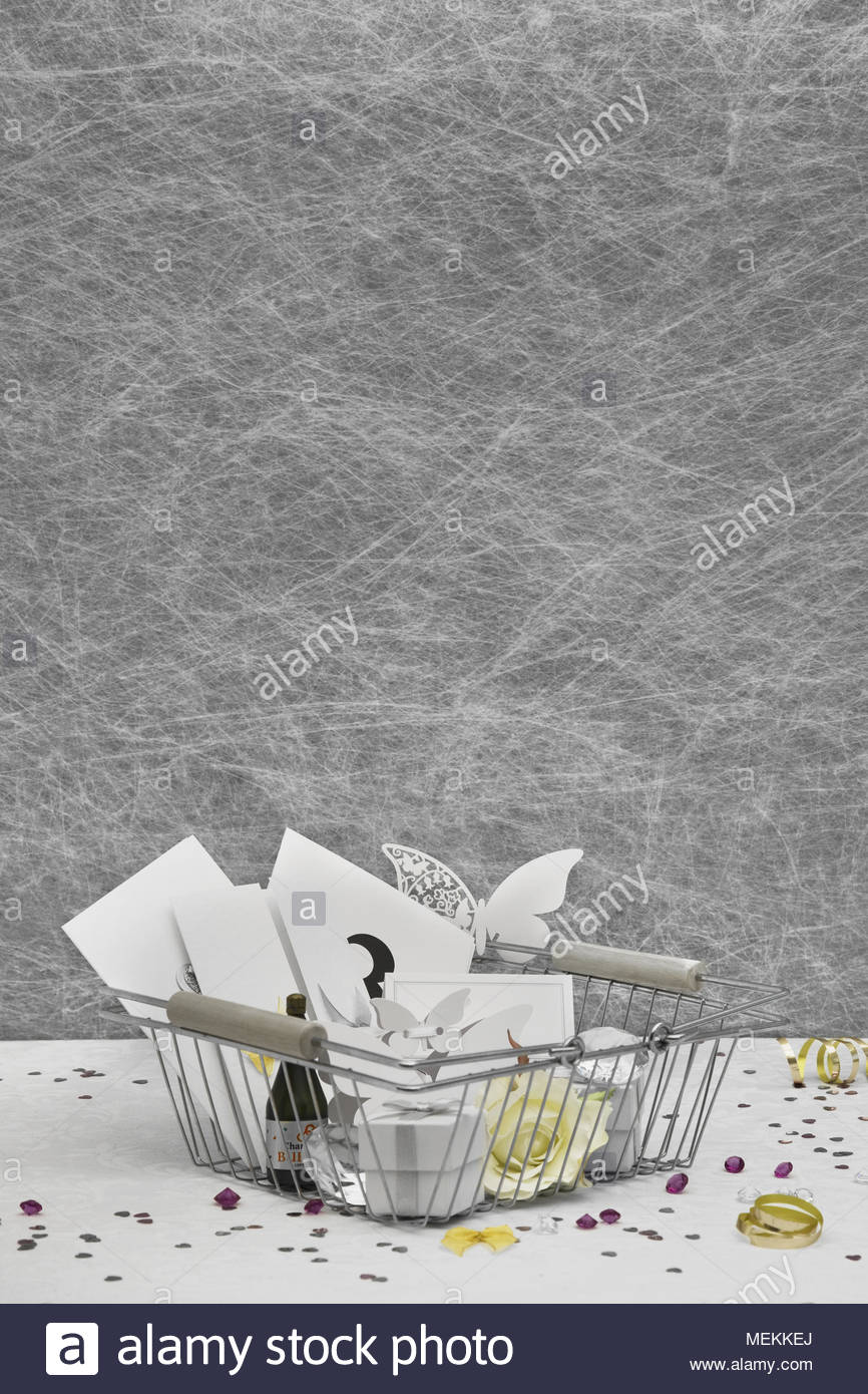 Wedding Favors In A Shopping Basket On A White Tablecloth With