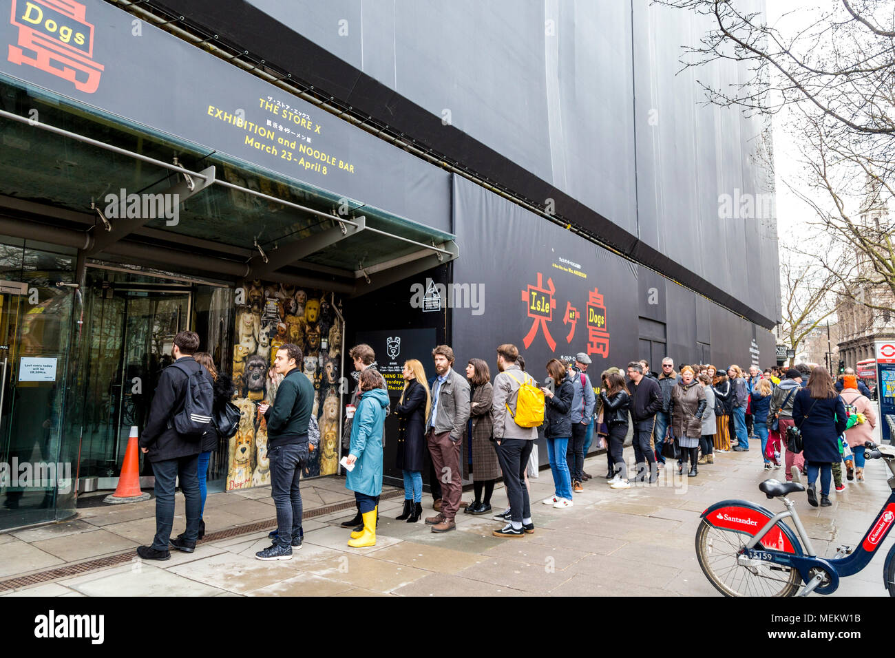 Long queue to the Wes Anderson 'Isle of Dogs' exhibition at the Strand, London, UK - Stock Image