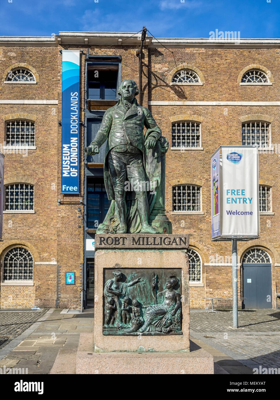 WEST INDIA DOCKS, LONDON:  Statue of Robert Milligan (1746-1809),  by Vincent Butler RSA.  A Leading figure in the  the construction of the docks - Stock Image