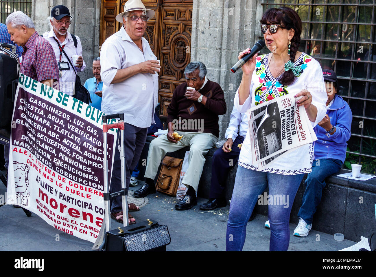 Mexico City Mexico Ciudad de Federal District Distrito DF D.F. CDMX Mexican Hispanic Centro Historico Historic Center Centre Avenida Juarez leftist political rally Movimiento Regeneracion Nacional Morena poster man woman spokeswoman speaker microphone North America American - Stock Image