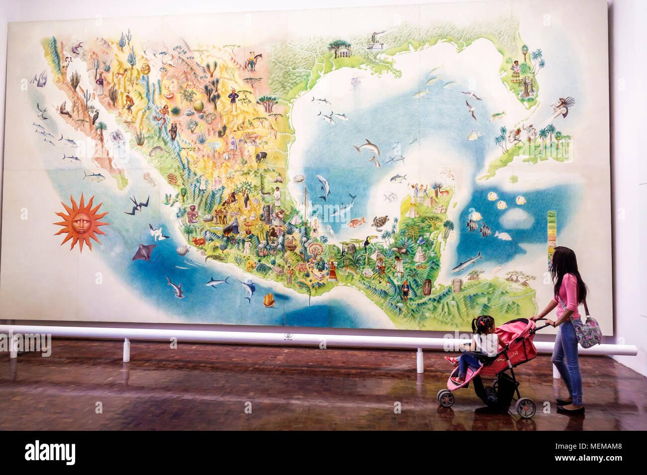 Mexico City Mexico Ciudad de Federal District Distrito DF D.F. CDMX Mexican Hispanic Centro Historico Historic Center Centre Museo de Arte Popular Popular Art Museum folk art inside exhibit mural map Miguel Covarrubias Gulf of Mexico regional cultures woman girl teen boy family looking North America American - Stock Image