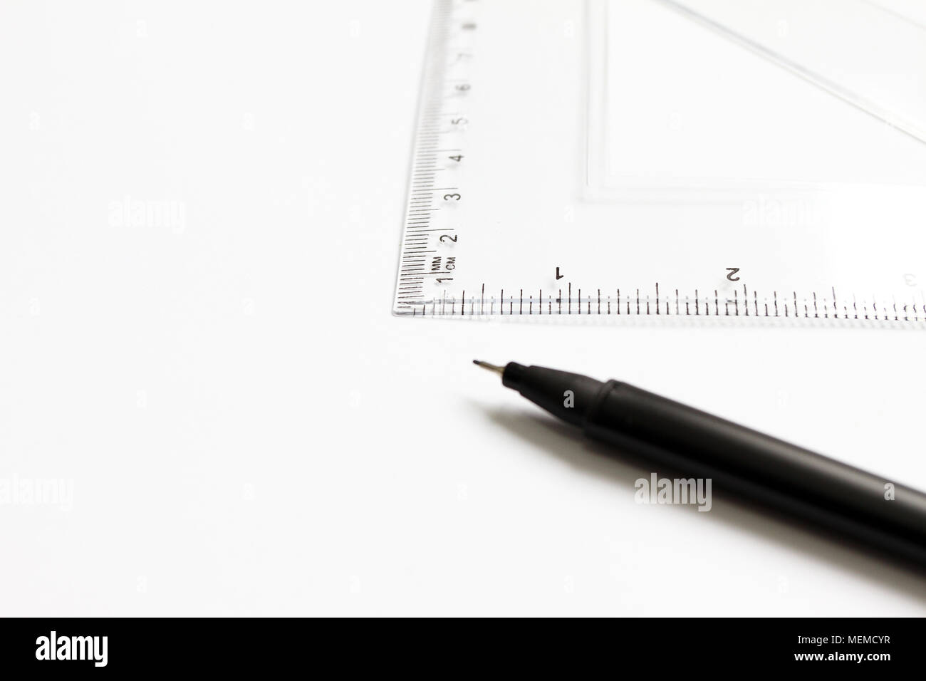 Mathematical accessories. Triangle ruler for math and black pen for ...