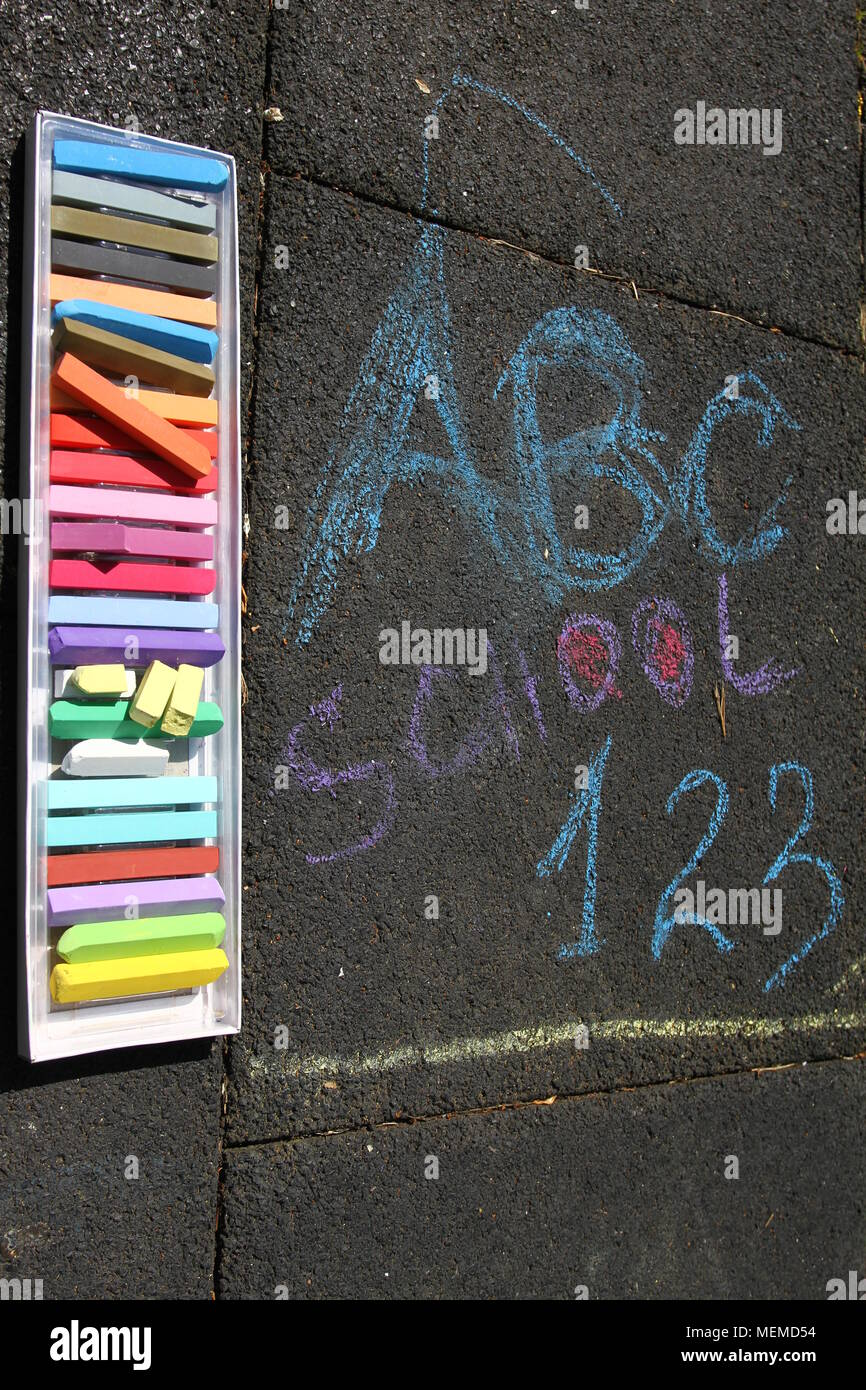 School, ABC and 123 sigh written with colored chalks on a pavement. Drawing Back to school on an asphalt. and vacation concept. Education concept. Sch Stock Photo