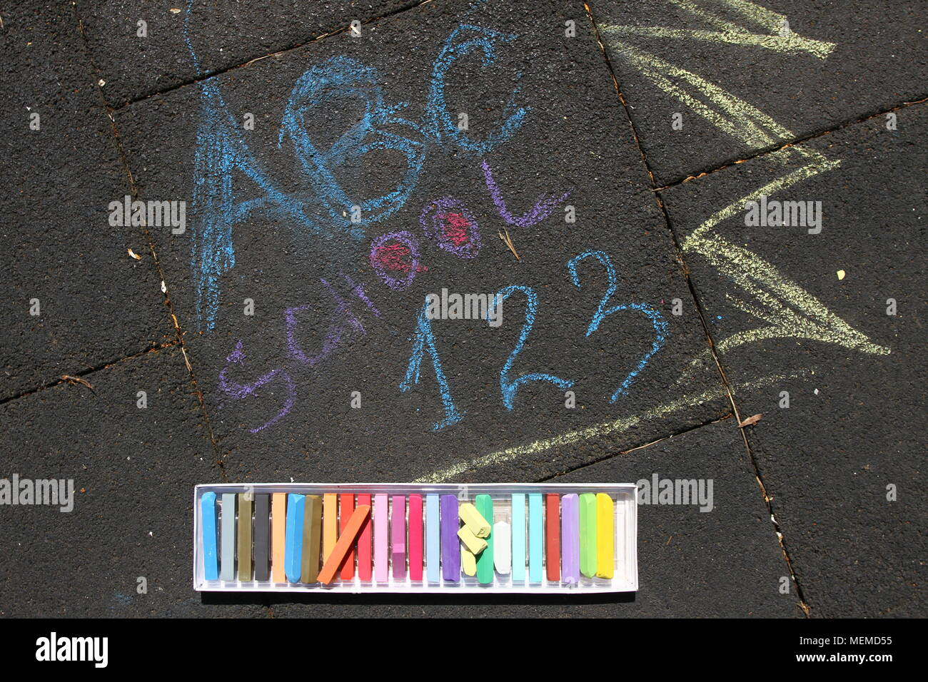 School, ABC and 123 sigh written with colored chalks on a pavement. Drawing Back to school on an asphalt. and vacation concept. Education concept. Sch - Stock Image