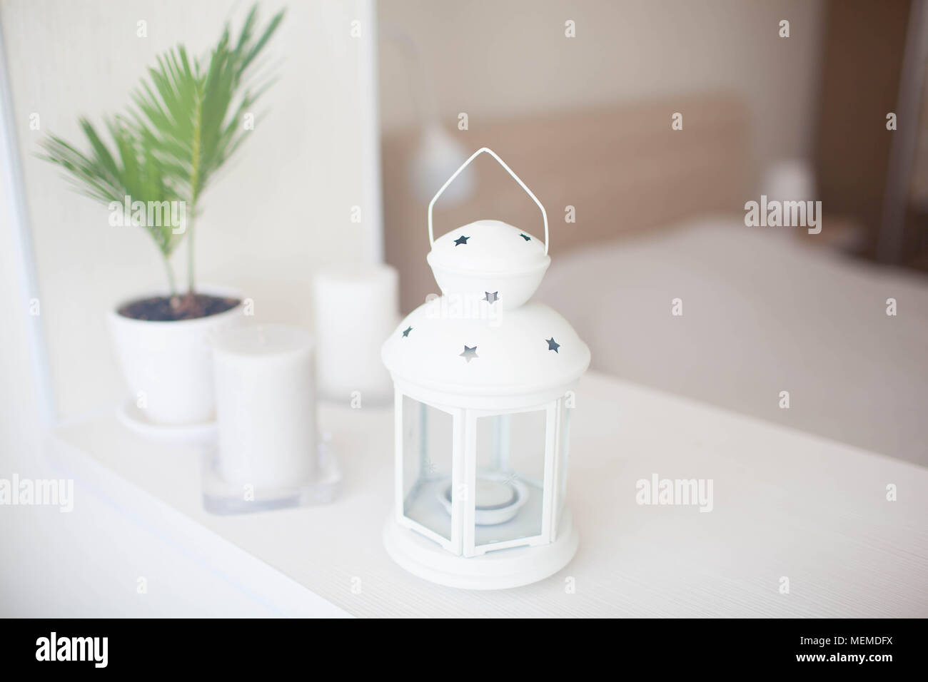 White lantern in the home interior - Stock Image