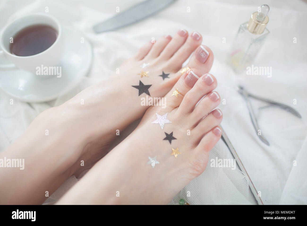 Beautiful French pedicure on a white background. - Stock Image