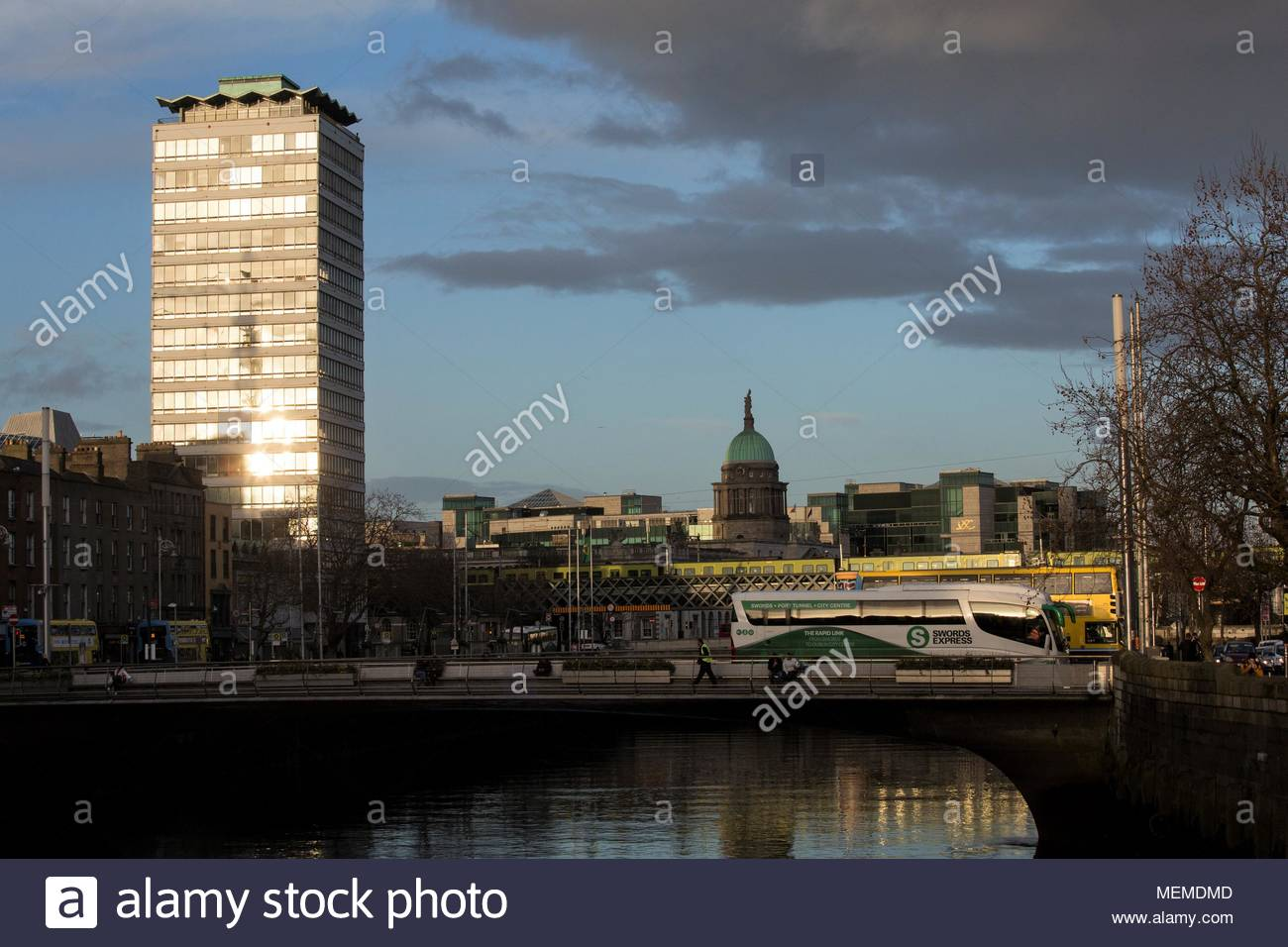 A beautiful evening scene in Dublin showing homebound traffic as light bounces off Liberty Hall. Credit reallifephotos/Alamy - Stock Image