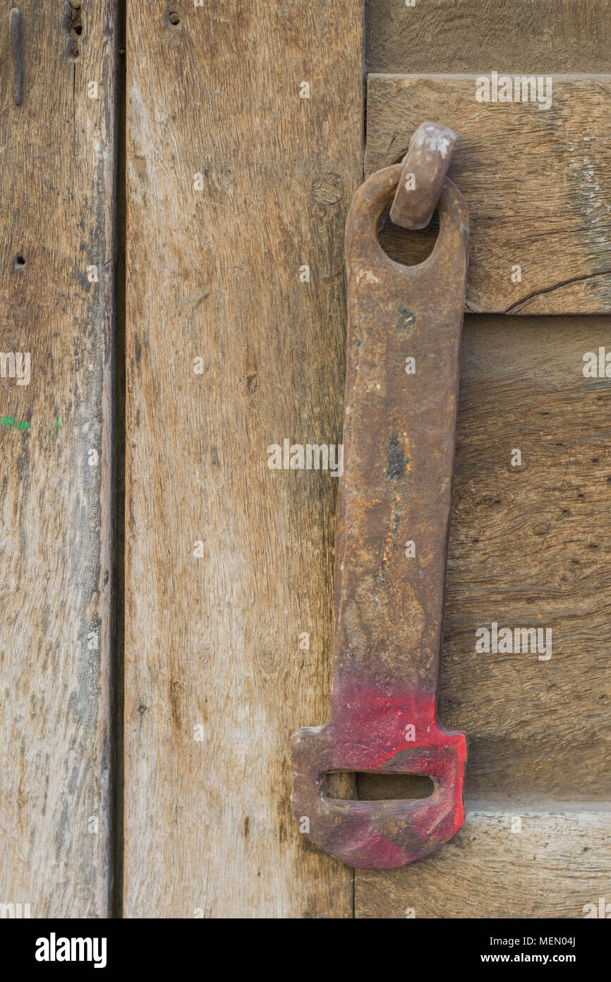 Isolated, close-up of hardware on an aged, grainy wooden gate, in Mexico - Stock Image