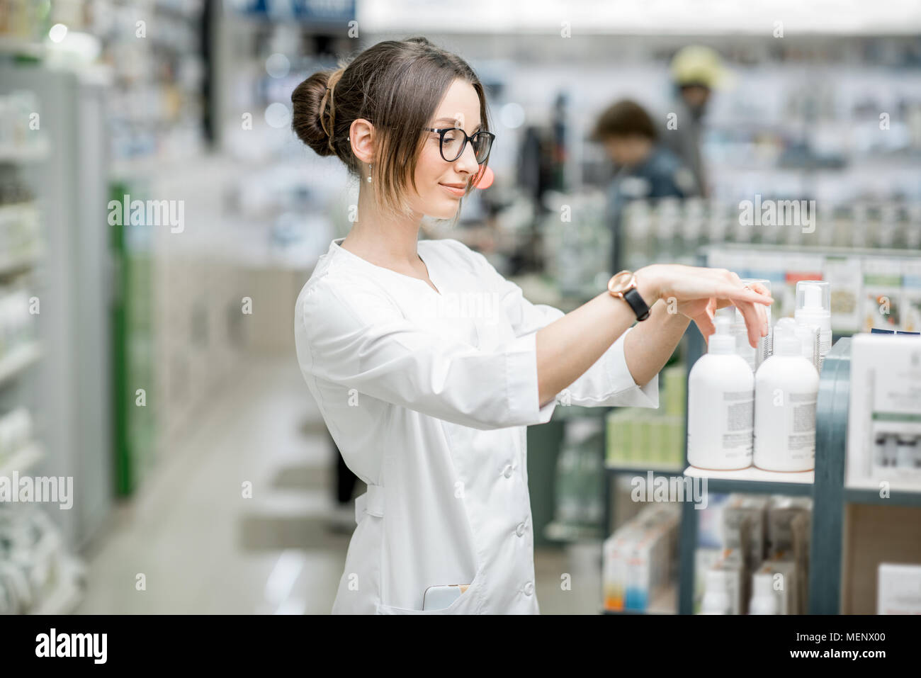 Pharmacist working in the pharmacy store - Stock Image