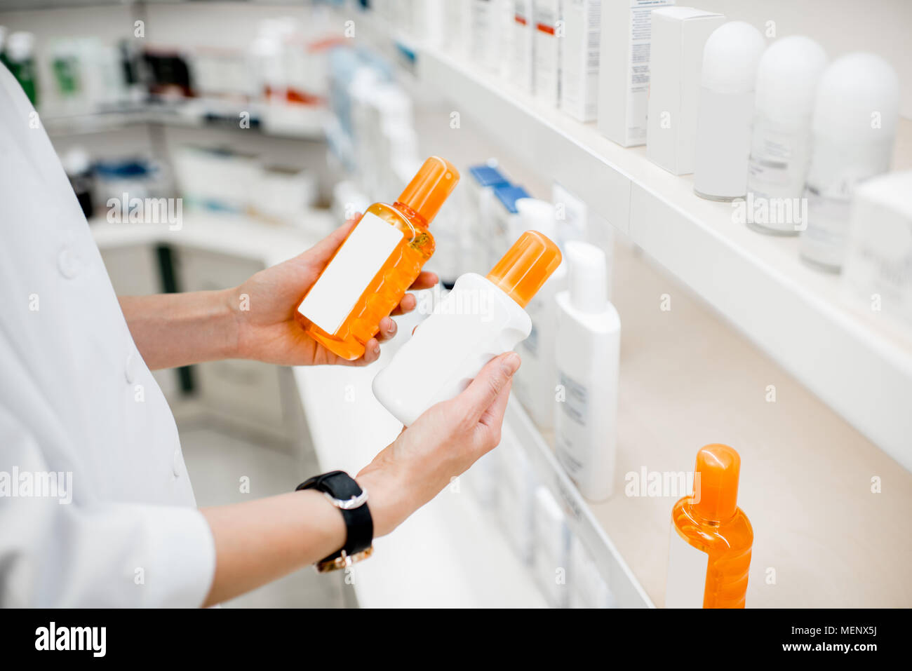 Taking sunscreen lotion at the pharmacy - Stock Image
