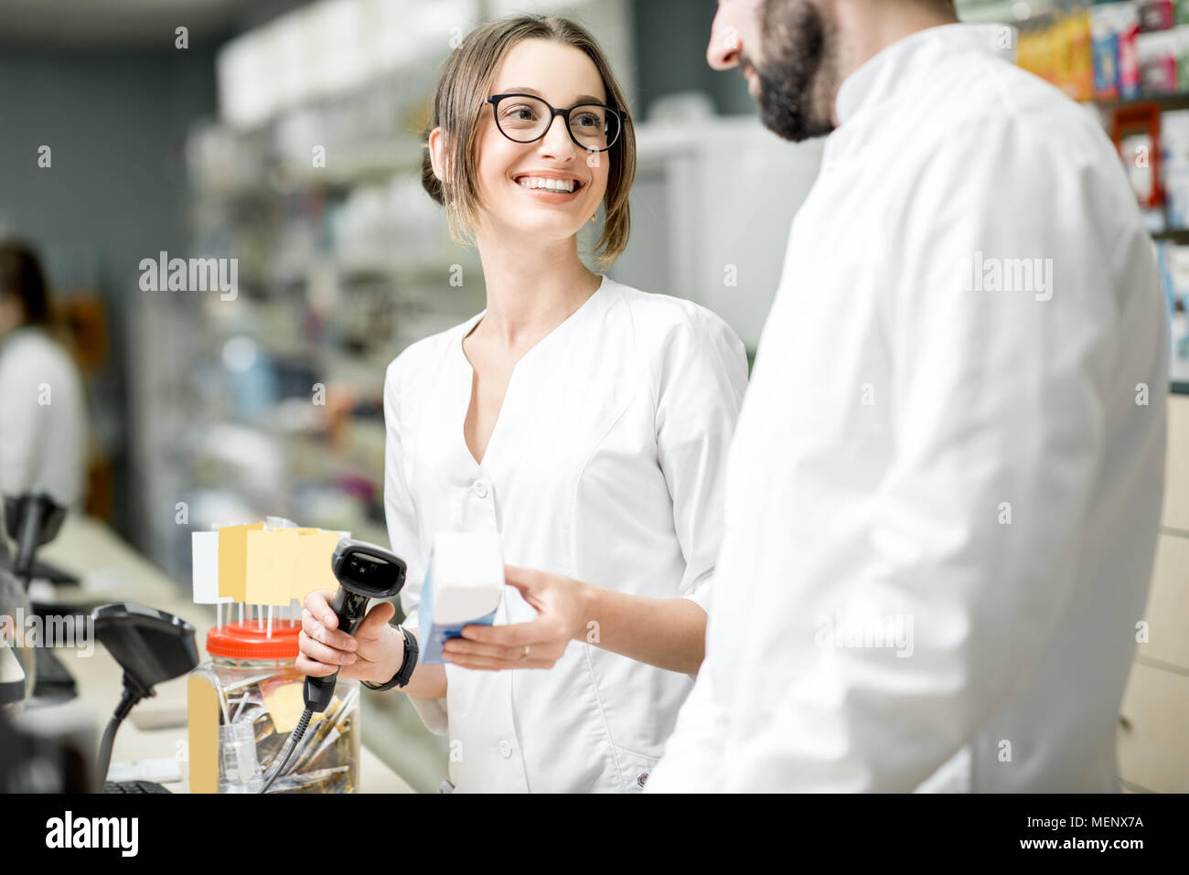 Pharmacists working in the pharmacy store Stock Photo