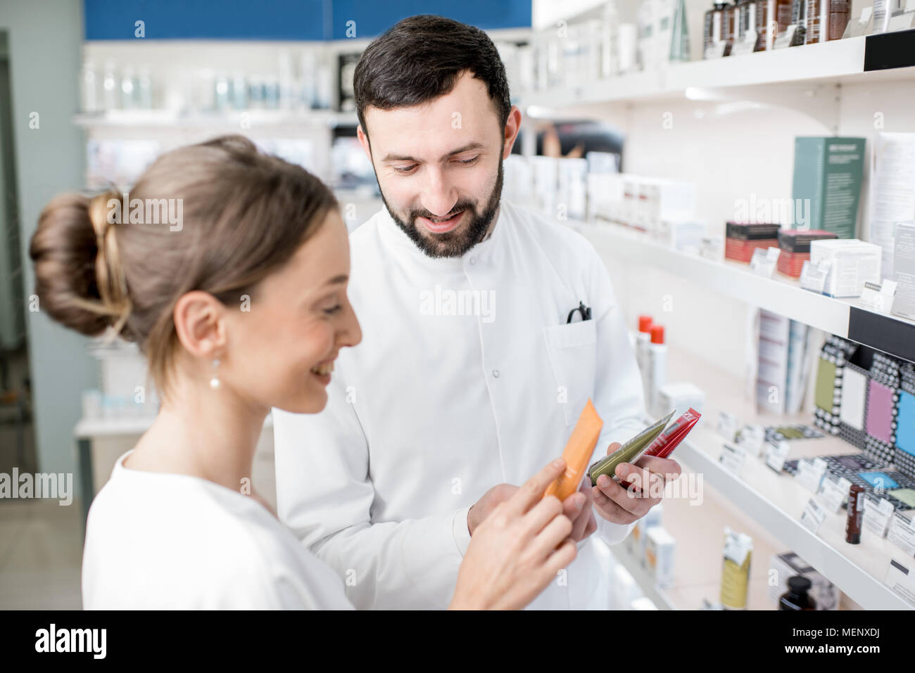 Pharmacist with client in the pharmacy store Stock Photo