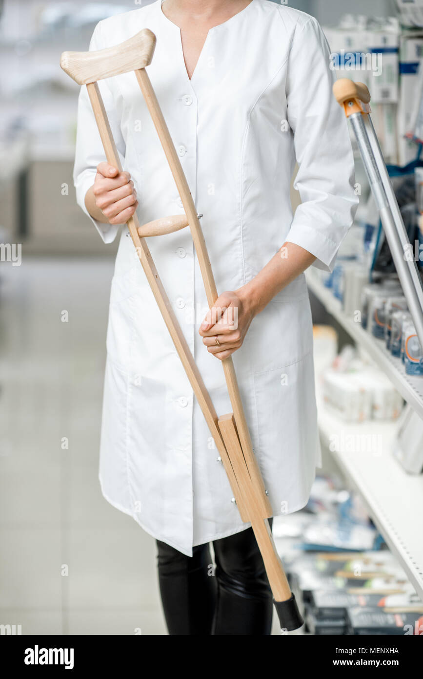 Doctor holding crutches - Stock Image