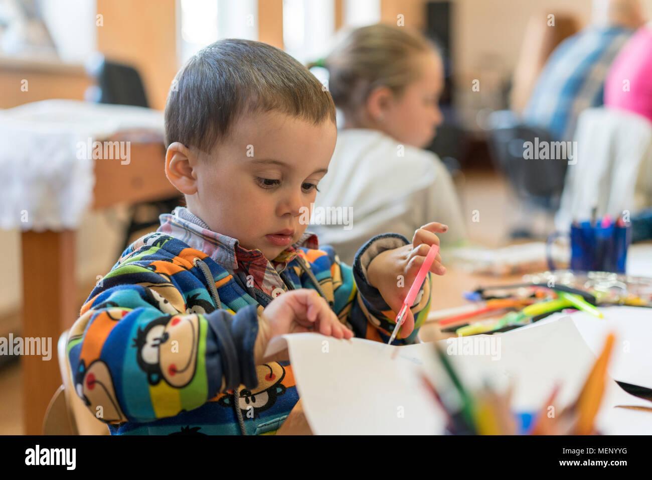 boy cutting drawing scissors stock photos amp boy cutting
